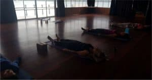 people in savasana yoga pose 1